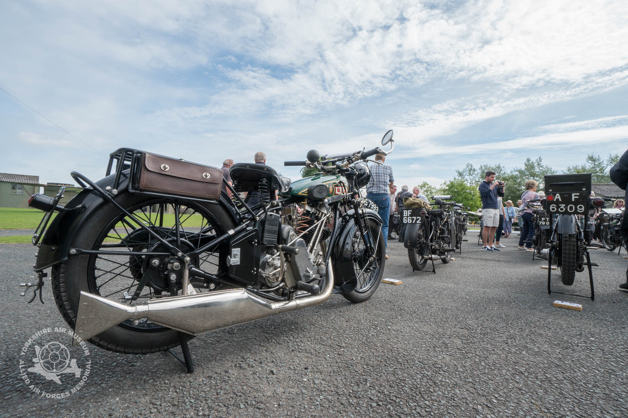 More than fifty veteran and vintage motorcycles readying for the off