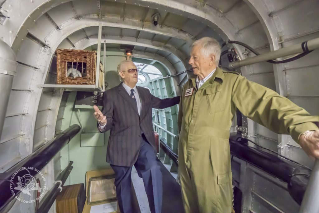 Phil Kemp (right) showing a member of The Guinea Pig Club around Halifax Friday 13th